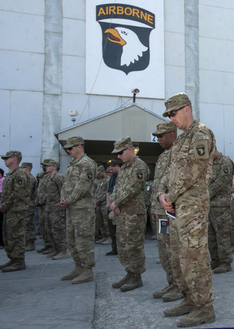 U.S. service members gathered for a ceremony on the 12th anniversary of the 9/11 terrorist attacks Wednesday in front of the World Trade Center Memorial at Bagram Airfield, Afghanistan. (AP Photo/ ...