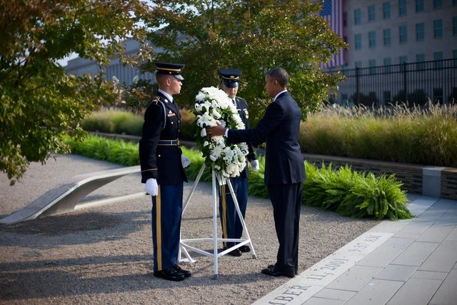 President Barack Obama places a wreath at the Pentagon 9/11 Memorial Wednesday at the Pentagon during a ceremony to mark the 12th anniversary of the 9/11 attacks. (AP Photo/Pablo Martinez Monsivais)