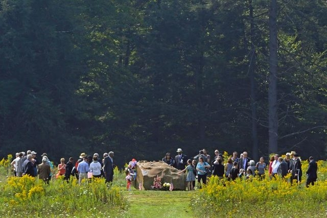 The family and friends of the passengers and crew of Flight 93 gather around a bolder that marks the plane's impact area during a memorial service at the Flight 93 National Memorial on Wednesday S ...