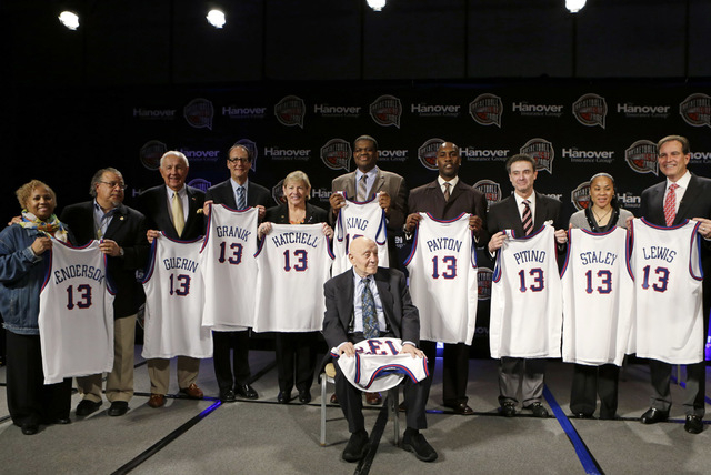 Members of the 2013 Naismith Memorial Basketball Hall of Fame class line up for a photo after inductee announcements on April 8 in Atlanta, Georgia. Shown standing behind Jerry Tarkanian from left ...