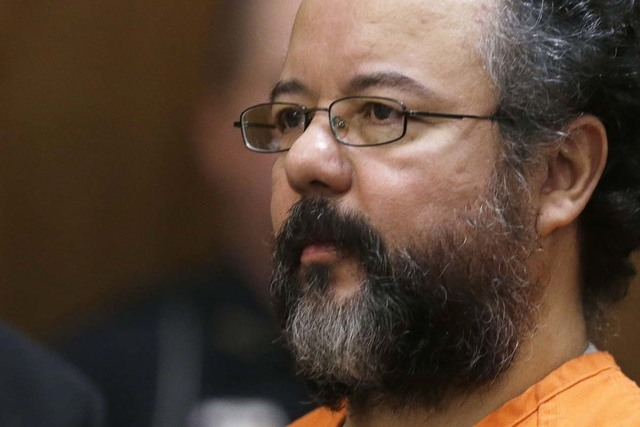 Ariel Castro listens in the courtroom during the sentencing phase Thursday, Aug. 1, 2013, in Cleveland. Three months after an Ohio woman kicked out part of a door to end nearly a decade of captivi ...