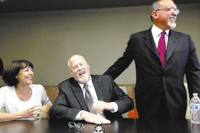 Harvey Whittemore, center, with his wife, Annette, jokes with his lead defense attorney, Dominic Gentile, during a news conference on May 29, 2013, in Reno, shortly after he was convicted of three ...