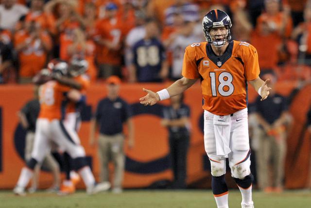 Denver Broncos quarterback Peyton Manning celebrates his seventh touchdown of the game against the Baltimore Ravens on Thursday in Denver. (AP Photo/Jack Dempsey)