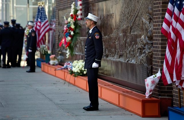An FDNY firefighter stands at attention at 10:03 a.m. Wednesday at a firefighter's memorial near One World Trade Center on the 12th anniversary of the Sept. 11, 2001 attacks. This moment marks whe ...