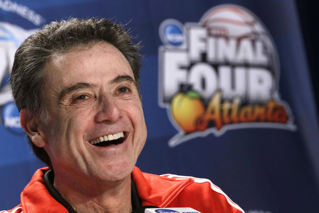 File-This April 4, 2013 file photo shows Louisville head coach Rick Pitino speaking to the media during a news conference at the Final Four of the NCAA college basketball tournament,  in Atlanta.  ...