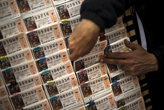 Tickets for Spain's famed Christmas lottery, the richest in the world, are shown in this 2012 file photo. (AP Photo/Daniel Ochoa de Olza)