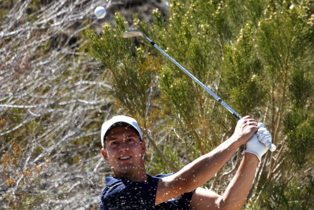 Taylor Montgomery of Foothill High School hits out of a bunker during a league match at the Anthem Country Club in Henderson, Nev. Tuesday, March 12, 2013.  (John Locher/Las Vegas Review-Journal)
