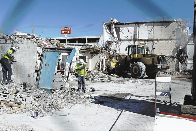 Workers Demolish A Hotel Room Wing Of The Former Western Monday In Downtown
