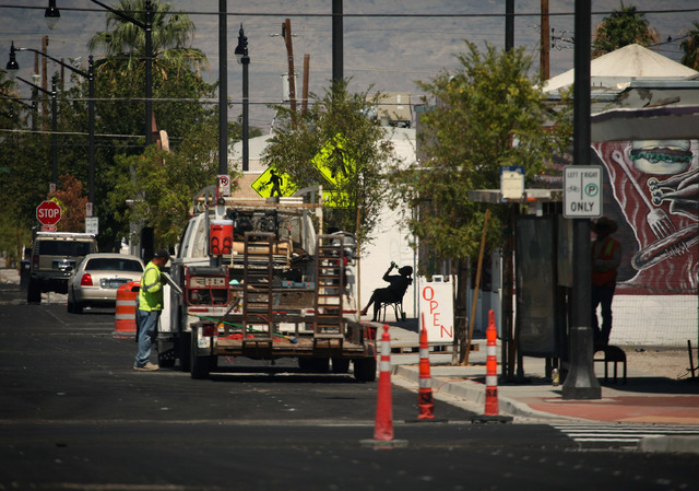 A person takes a drink amid construction along D Street in Las Vegas Wednesday, Sep. 4, 2013.  (Jessica Ebelhar/Las Vegas Review-Journal)