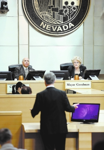 Las Vegas Councilman Stavros Anthony, left, and Mayor Carolyn Goodman, right, listen to Bob Halstead, director of the Nevada Agency for Nuclear Projects, speak at City Hall Wednesday, Sept. 4, 201 ...