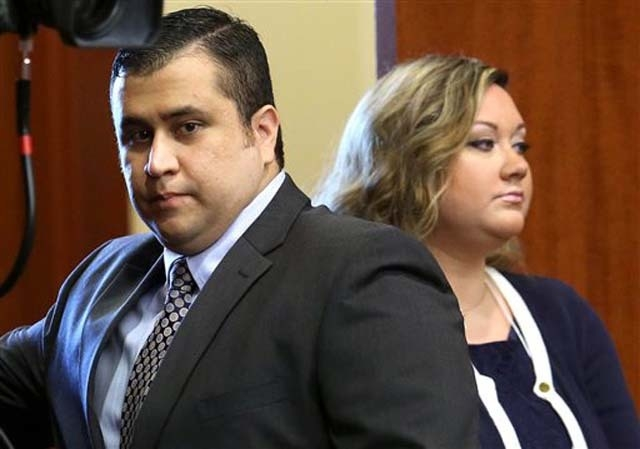 In this June 24, 2013 file photo, George Zimmerman, left, arrives in Seminole circuit court, with his wife Shellie, in Sanford, Fla. Shellie Zimmerman called police on Monday saying her husband th ...