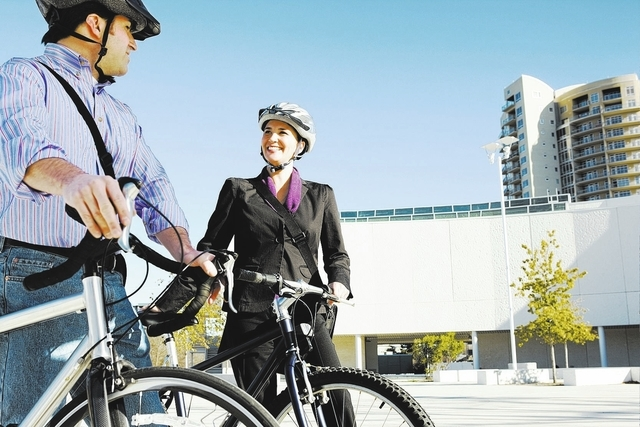 Businesspeople commuting to work on bicycles