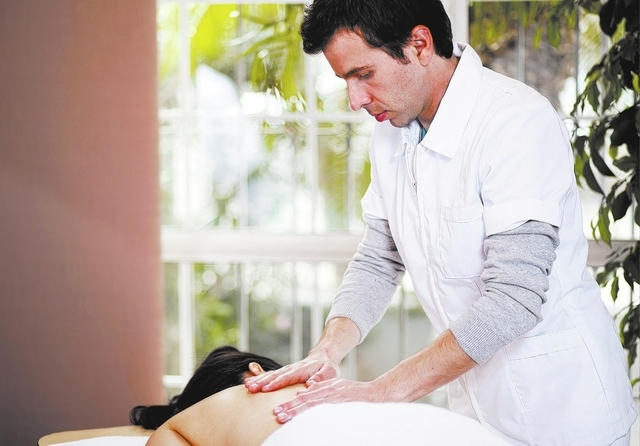 Young masseuse working at a spa