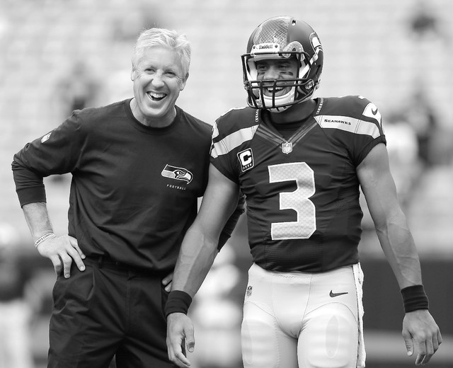 Coach Pete Carroll, left, has turned the Seattle Seahawks into a spread-covering machine, going 16-5 ATS in the past 21 games, led by quarterback Russell Wilson, right. (AP Photo/Bob Leverone, file)