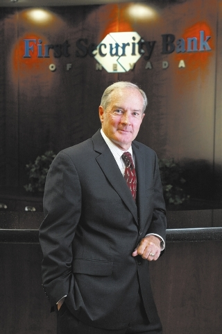 CRAIG L. MORAN/LAS VEGAS REVIEW-JOURNAL John Sullivan, president and chief executive officer of First Security Bank of Nevada, is shown in the lobby of the bank on Thursday, Aug. 11, 2011, in Las  ...