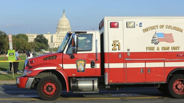 A Washington, D.C. ambulance leaves the scene where a man set himself on fire near the U.S. Capitol building on the National Mall in Washington, October 4, 2013. The man was rushed to a local hosp ...
