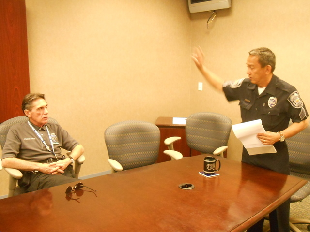 North Las Vegas' Volunteers in Police Services Citizen's Patrol founder Richard Cherchio, left, talks about the program with Sgt. Ed Ortiz Oct. 14 at North Las Vegas Police Department Northwest Ar ...