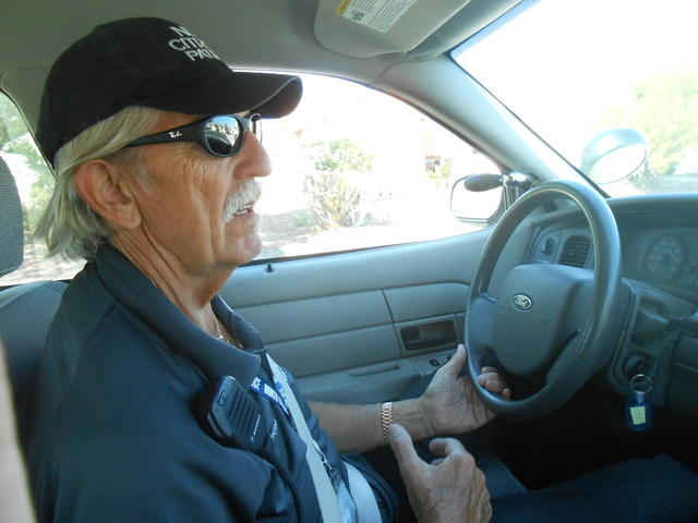 North Las Vegas' Volunteers in Police Services Citizen's Patrol director Joe Cavender out on patrol Oct. 14, near the intersection of Washburn Road and Allen Lane. Cavender, one of the group's ori ...