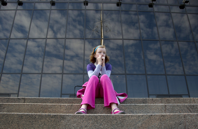 Fay Wagstaff of El Paso, Texas. sits on the front steps of the closed Smithsonian National Air and Space Museum in Washington, Tuesday, Oct. 1, 2013. Congress plunged the nation into a partial gov ...