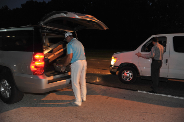 Robert Van Hoorebeck, left, loads his bag and golf bag into Richard Wood's vehicle Tuesday after the Jacksonville International Airport was evacuated in Jacksonville, Fla. Wood, a district manager ...