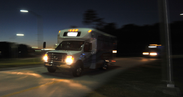 Shuttles used to move people out of Jacksonville International Airport drive by Tuesday, Oct. 1, 2013, in Jacksonville, Fla. The airport was evacuated after authorities found two suspicious packag ...