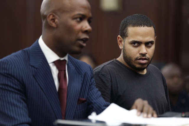 Christopher Cruz, right, appears in criminal court with his lawyer H. Benjamin Perez in New York, Wednesday, Oct. 2, 2013.  Cruz, 28, of New Jersey, was charged Wednesday with reckless driving aft ...