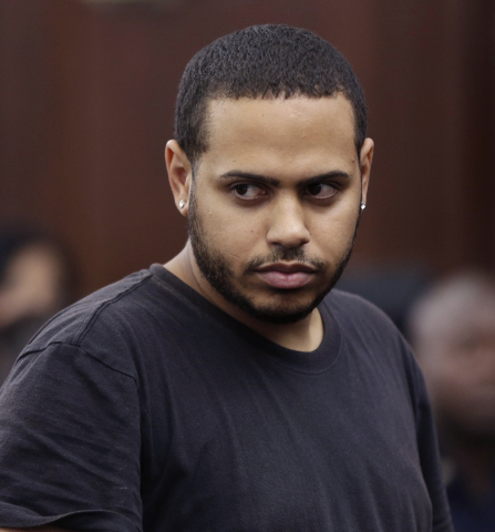 Christopher Cruz appears in criminal court in New York, Wednesday, Oct. 2, 2013.  Cruz, 28, of New Jersey, was charged Wednesday with reckless driving after prosecutors said he touched off a tense ...