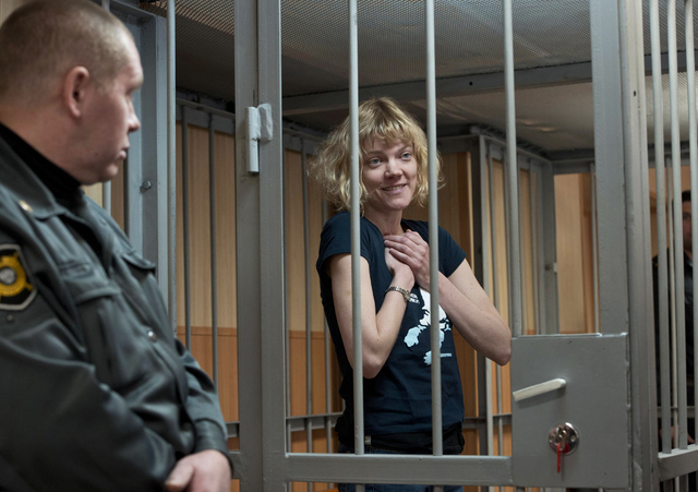 In this Sunday, Sept. 29, 2013 file photo provided by Greenpeace, Greenpeace International activist Sini Saarela of Finland stands in a cage at the Leninsky District Court of Murmansk, Russia. Gre ...