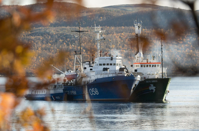In this image made available by Greenpeace on Tuesday, Oct 1, 2013, 2013, the Greenpeace ship, the Arctic Sunrise, right, is anchored side by side with the Russian Coast Guard Ship in the Kolskii  ...