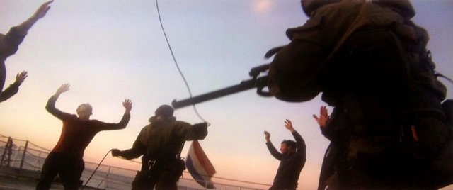 In this image provided by Greenpeace on Wednesday, Oct. 2, 2013 and made off a computer screen with a mobile phone camera of video footage recorded on Thursday, Sept. 19, 2013, Russian Coast Guard ...