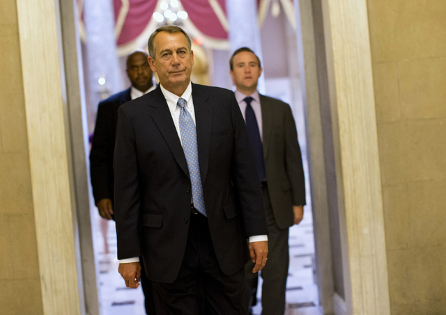 House Speaker John Boehner of Ohio walks to his office on Capitol Hill in Washington on Wednesday. The Republican-run House has rejected an effort by Democrats to force a quick end to the partial  ...
