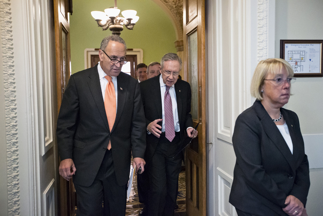 From left, Sen. Charles Schumer, D-N.Y., Senate Majority Leader Harry Reid of Nev., and Senate Budget Committee Chair Sen. Patty Murray, D-Wash., walk to a news conference on Capitol Hill in Washi ...