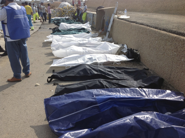 Bodies of drowned migrants are lined up in the port of Lampedusa, Sicily, on Thursday. At least 94 people died when a ship carrying African migrants toward Italy caught fire and sank off the Sicil ...