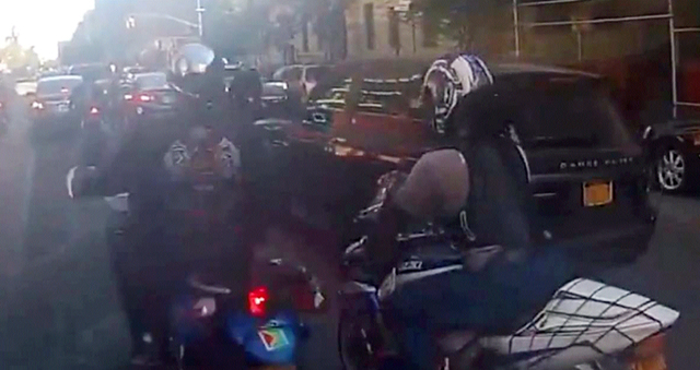 In this frame grab from video provided by the New York Police Department, motorcyclists ride alongside a sport utility vehicle, Sunday, Sept. 29, 2013, in New York. Police say that a man driving w ...