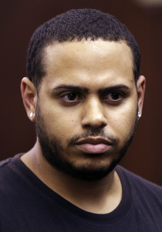 Christopher Cruz appears in criminal court in New York, Wednesday, Oct. 2, 2013. Cruz was charged Wednesday with reckless driving after prosecutors said he touched off a tense encounter with the d ...
