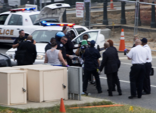 Emergency personnel wheel off an injured person after a shooting on Capitol Hill in Washington on Thursday. Police say the U.S. Capitol was put on a security lockdown amid reports of shots fired o ...
