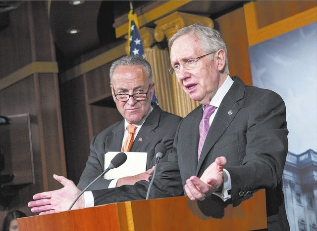 Senate Majority Leader Harry Reid of Nev., right, accompanied by Sen. Charles Schumer, D-N.Y., announces to reporters on Capitol Hill in Washington, Wednesday, Oct. 2, 2013, that President Barack  ...