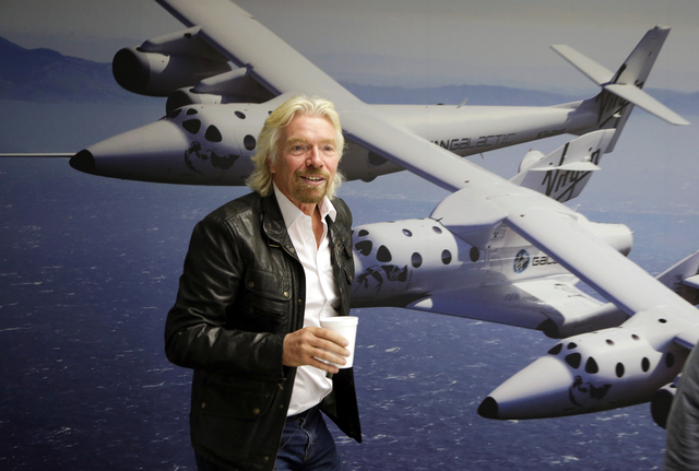 This Sept. 25, 2013 file photo shows British entrepreneur Richard Branson at the Virgin Galactic hangar at Mojave Air and Space Port in Mojave, Calif. NBC says it will air a competition show with  ...