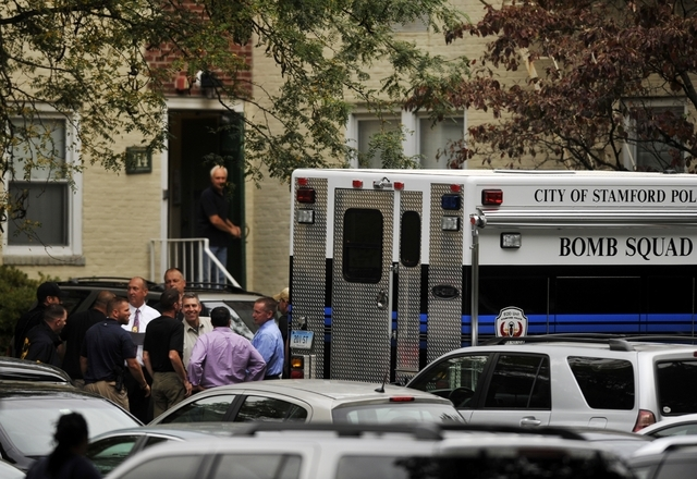 Law enforcement from local, state and federal jurisdictions investigate the residence of Miriam Carey in Stamford, Conn., on Thursday. Law-enforcement authorities have identified Carey, 34, as the ...