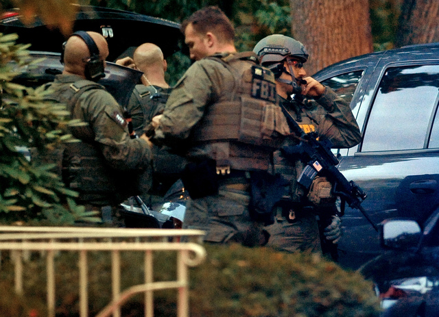 Members of the FBI suit up outside the residence of Miriam Carey in Stamford, Conn., on Thursday. Law-enforcement authorities have identified Carey, 34, as the woman who led Secret Service and pol ...