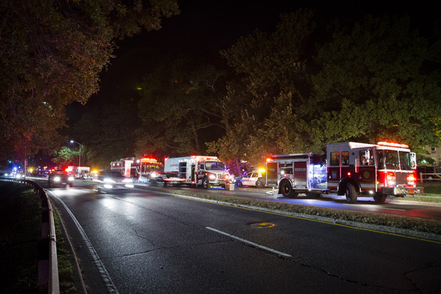 Emergency response vehicles wait outside the apartment complex Thursday where Miriam Carey is believed to have lived in Stamford, Conn. (AP Photo/John Minchillo)