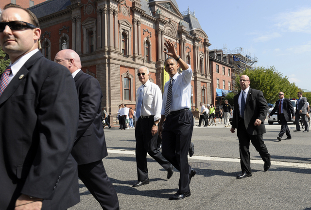 President Barack Obama and Vice President Joe Biden leave the White House in Washington, Friday, Oct. 4, 2013, to pick up lunch at Taylor Gourmet sandwich shop near the White House. The president  ...