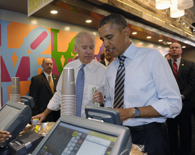 President Barack Obama and Vice President Joe Biden order lunch at Taylor Gourmet sandwich shop near the White House in Washington, Friday, Oct. 4, 2013. The president and vice president stepped o ...