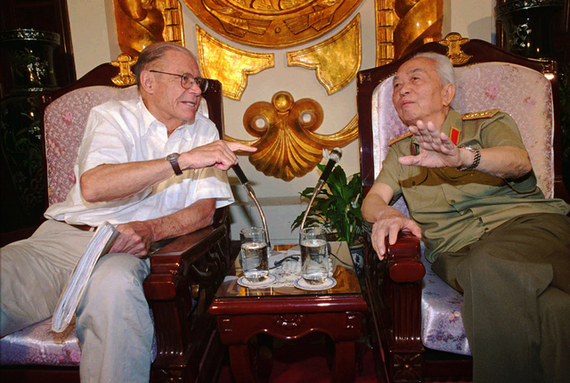 FILE - In this Monday, June 23, 1997 file photo, former U.S. Defense Secretary Robert McNamara, left, speaks to his onetime foe Gen. Vo Nguyen Giap in Hanoi. Officials say legendary Gen. Giap, the ...
