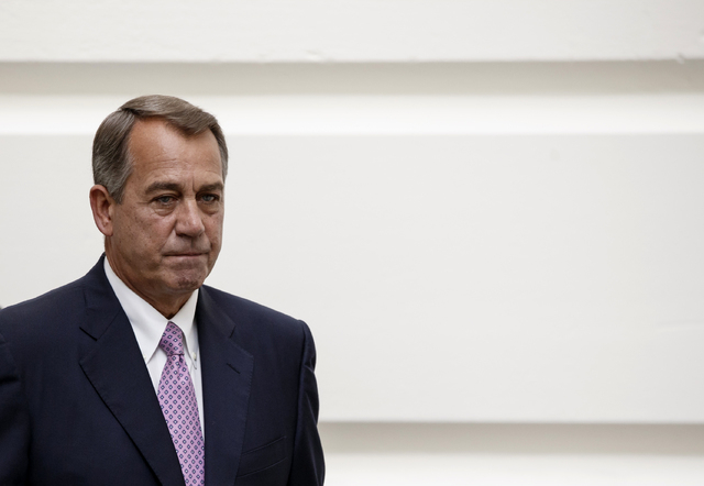 House Speaker John Boehner of Ohio walks to a Republican strategy session on Capitol Hill in Washington, Friday, Oct. 4, 2013. Boehner is struggling between Democrats that control the Senate and G ...