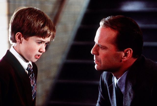 """FILE - In this publicity photo released by Spyglass Entertainment, Haley Joel Osment, left, and Bruce Willis appear in a scene from the film """"The Sixth Sense,"""" a tale of a child who can  ..."""