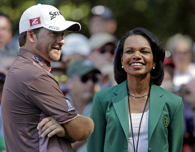 In this April 10, 2013, file photo, former Secretary of State Condoleezza Rice, right, speaks with Graeme McDowell, of Northern Ireland, during the par-3 competition at the Masters golf tournament ...