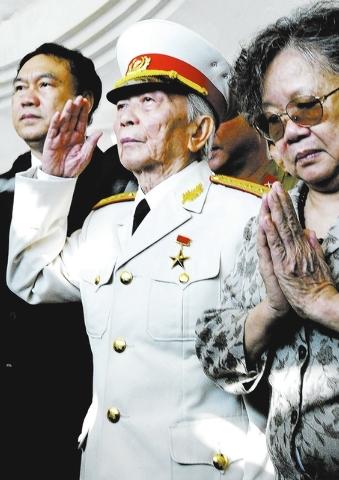 In this April 18, 2004 file photo, Gen. Vo Nguyen Giap salutes his fallen comrades at a shrine of the Dien Bien Phu's war cemetery in Dien Bien Phu, Vietnam. Officials say legendary Gen. Giap, the ...