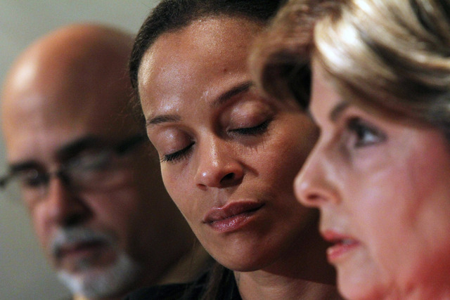 Attorney Gloria Allred, right, speaks as Edwin Mieses Sr., left, and Dayana Mejia listen during a news conference, Friday, Oct. 4, 2013, in New York. Mejia, the longtime girlfriend of biker Edwin  ...