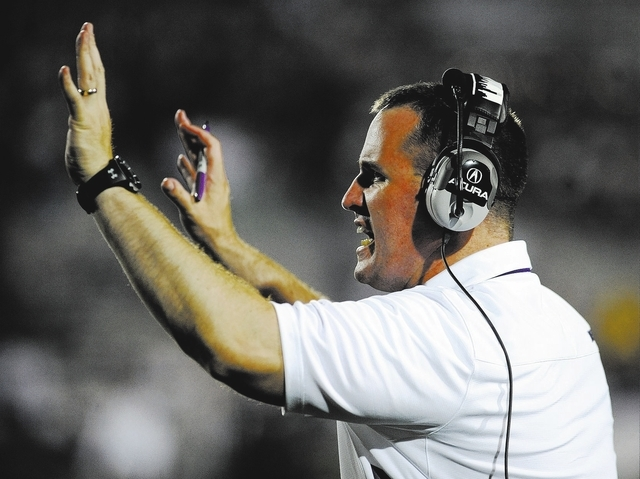 Northwestern coach Pat Fitzgerald yells in the second half of an NCAA college football game against Syracuse in Evanston, Ill., in this Sept. 7, 2013 file photo. The college football weekend is hi ...